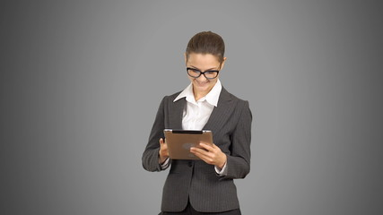young beautiful business woman working on the tablet.