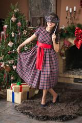 Girl on carnival  near Christmas tree