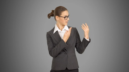 Young beautiful business woman showing copy space and speaks.