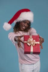 Beautiful woman portrait sharing Christmas gift