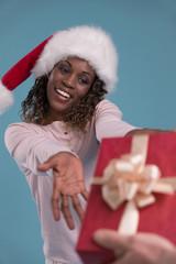 Beautiful woman portrait taking Christmas gift