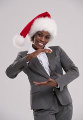 Smiling african Santa Girl presenting product