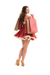 Woman in Santa Claus dress with shopping bags