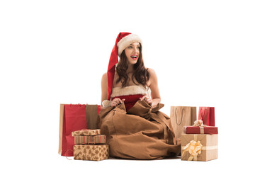 Christmas woman appearing from Santa Claus sack
