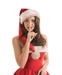 Christmas woman wearing a santa hat showing silence gesture