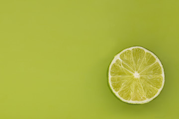 Lime slice on a green background