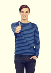 smiling teenage boy showing thumbs up