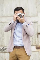 Men taking photo with film camera