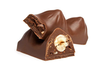 Chocolate bar with nuts on a white background