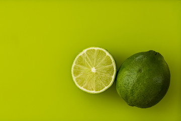 Limes on a green background