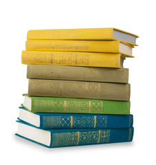 stack of colorful books in the textile cover on isolated white