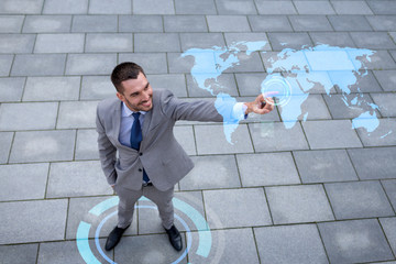 smiling businessman with world map projection