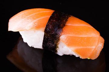 salmon sake nigiri on black