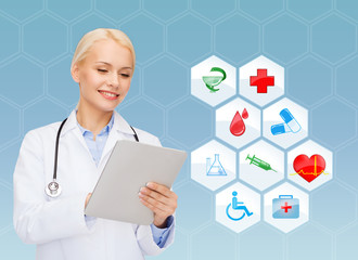 smiling doctor with tablet pc and medical symbols