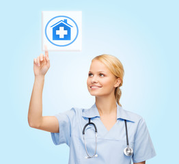 smiling doctor or nurse pointing to pills icon