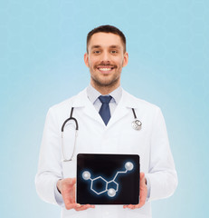 smiling male doctor showing tablet pc screen