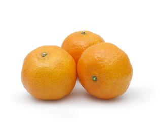 three tangerines on white background