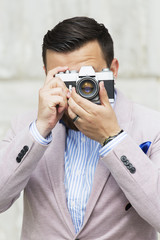 Men taking photo on film camera