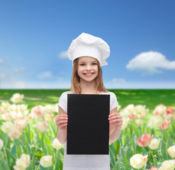 little cook or baker with blank black paper