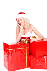 Beautiful Blonde Girl in Santa Hat isolated. Portrait