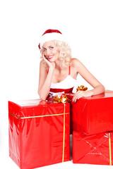 Beautiful Blonde Girl in Santa Hat isolated. Portrait