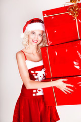 Beautiful Blonde Girl in Santa Hat isolated.