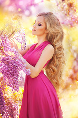 Fashion young woman with lilac flowers