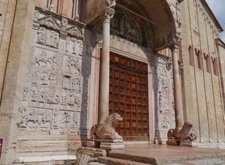 Red marble lions in front of the San Zeno In Verona