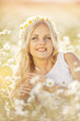 Beautiful woman enjoying daisy field,