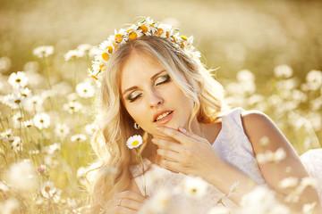 Beautiful woman enjoying daisy field,