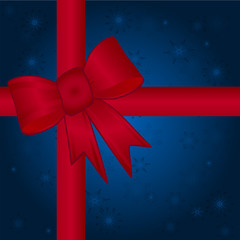 Red Bownd Ribbon Over a Blue Snowflake Background