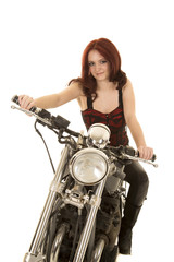 woman red hair motorcycle look smile