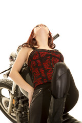 woman red top motorcycle lay back look up