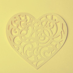 carving heart cutted from paper on the paper background