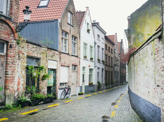 Medieval empty side street of Bruges, Belgium, with a bike parke