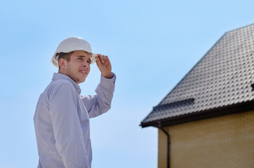 Engineer or building inspector checking a roof