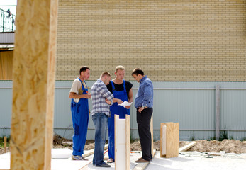 Group of builders having a meeting