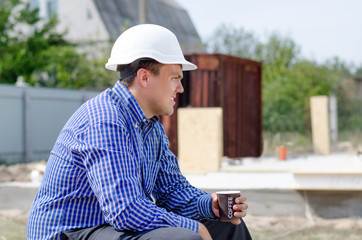Foreman taking a coffee break on a building site