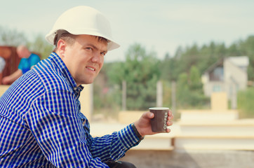 Site foreman taking a coffee break