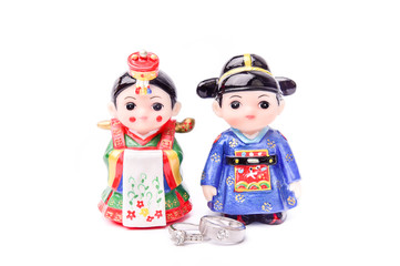 Korean's wedding doll with rings on White Isolate Background