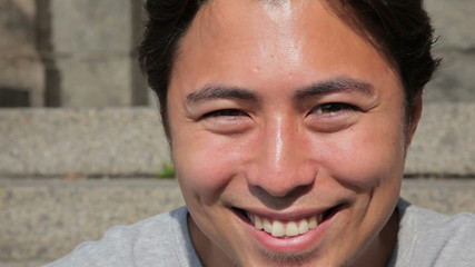 Closeup of a young attractive man smiling