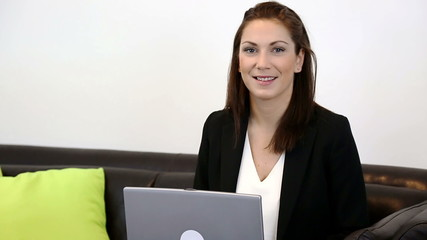Working businesswoman with a laptop