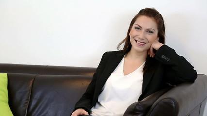 Businesswoman sitting down in sofa