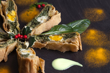 Pieces Of Chard Pie Decorated With Holly