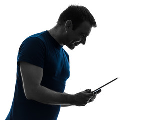 man holding digital tablet  smiling silhouette