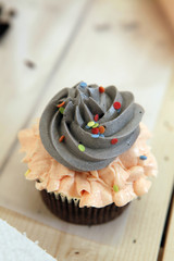 Decorated cupcake on table