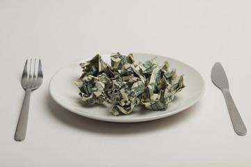 Dollar bill, dish, fork, knife