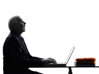senior business man computing looking up mouth open silhouette