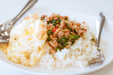 Rice topped with stir-fried pork and basil also Pad krapaw kaida