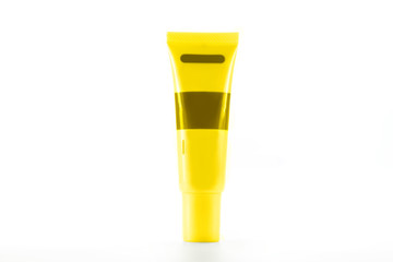 Yellow cream Cosmetics bottle on White background